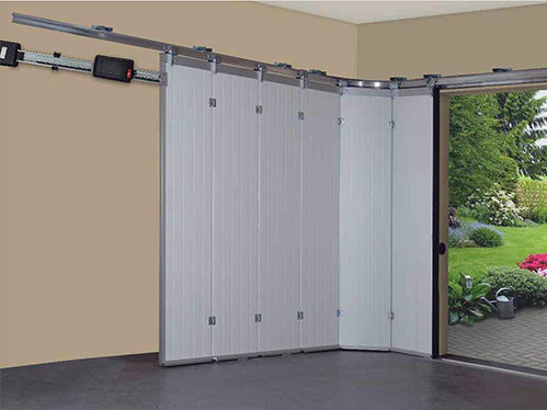 La porte de garage refoulement lat ral s 39 adapte tous for Porte de garage automatique coulissante