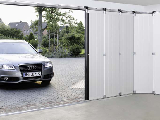 Porte de garage sectionnelle lat rale couleur blanche for Porte de garage sur mesure castorama