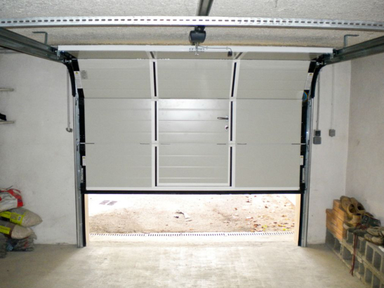 Porte sequentielle garage maison design for Porte de garage sectionnelle prix discount